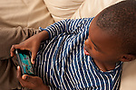 Five year old boy playing game on iPhone