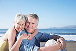 USA, California, Fairfax, Happy mature couple sitting on beach