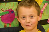 MR / Schenectady, NY. Zoller Elementary School (urban public school). Kindergarten inclusion classroom. Facial portrait of student (boy, 5) in classroom. MR: Bur12. ID: AM-gKw. © Ellen B. Senisi.