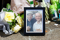 Pictured: A picture of Ryan O'Connor (L) left amongst flowers and tributes left by family, friends and locals in Balfe Road, in the Alway area of Newport, Wales, UK. Monday 14 June 2021<br /> Re: Three men and a boy have who have been charged with murdering a man and robbing him of a Gucci bag, have appeared before Magistrates Court in newport, Wales, UK.<br /> Ryan O'Connor, 26, who was known as Apple, died after being found unconscious and unresponsive in Balfe Road in the Alway area of Newport on Thursday at about 9pm.<br /> Lewis Aquilina, 19, Elliot Fiteni, 19, and Ethan Strickland, 18, all of Cardiff, appeared along with a 17-year-old boy at before Magistrates.<br /> Another 17-year-old boy, who cannot be named, faces the same charges.
