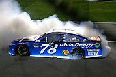 Monster Energy NASCAR Cup Series<br /> Go Bowling 400<br /> Kansas Speedway, Kansas City, KS USA<br /> Saturday 13 May 2017<br /> Martin Truex Jr, Furniture Row Racing, Auto-Owners Insurance Toyota Camry celebrates his win with a burnout<br /> World Copyright: Russell LaBounty<br /> LAT Images<br /> ref: Digital Image 17KAN1rl_5802