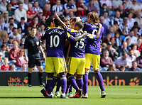 Sunday 01 September 2013<br /> Pictured:  Ben Davies of Swansea is mobbed by team mates celebrating his opening goal.<br /> Re: Barclay's Premier League, West Bromwich Albion v Swansea City FC at The Hawthorns, Birmingham, UK.
