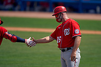 Washington Nationals third base coach Bob Henley (15) congratulates Yadiel Hernandez (29) after a home run during a Major League Spring Training game against the New York Mets on March 18, 2021 at Clover Park in St. Lucie, Florida.  (Mike Janes/Four Seam Images)