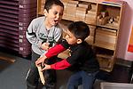 Education Preschool 4 year oldsconflict dispute over wooden train tracks between two boys