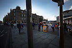 Heart of Midlothian 1 Birkirkara 2, 21/07/2016. Tynecastle Park, UEFA Europa League 2nd qualifying round. A programme seller doing business on Gorgie Road outside Tynecastle Park, Edinburgh as fans arrive before Heart of Midlothian played Birkirkara of Malta in a UEFA Europa League 2nd qualifying round, second leg. The match ended in victory for the Maltese side by 2-1 and they progressed on aggregate after the first match had ended 0-0. The game was watched by 14301 spectators, including 56 visiting fans of Birkirkara. Photo by Colin McPherson.