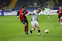 Aaron Galindo (Eintracht) im Zweikampf mit Artur Wichniarek (Bielefeld)<br /> Eintracht Frankfurt vs. Arminia Bielefeld, Commerzbank Arena<br /> *** Local Caption *** Foto ist honorarpflichtig! zzgl. gesetzl. MwSt. Auf Anfrage in hoeherer Qualitaet/Aufloesung. Belegexemplar an: Marc Schueler, Am Ziegelfalltor 4, 64625 Bensheim, Tel. +49 (0) 6251 86 96 134, www.gameday-mediaservices.de. Email: marc.schueler@gameday-mediaservices.de, Bankverbindung: Volksbank Bergstrasse, Kto.: 151297, BLZ: 50960101