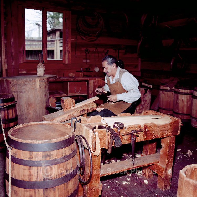Fort Langley National Historic Site, BC, British Columbia, Canada - Re-enactor Cooper making a Barrel in the Cooperage.  Fort Langley was founded in 1827 as a Hudson's Bay Company Trading Post.