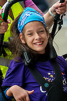 COPY BY TOM BEDFORD<br /> Sunday 26 June 2016<br /> Pictured: Poppy Jones full of smiles on race day <br /> Re: A very special father-and-daughter team have tackled the Cardiff Triathlon.<br /> Poppy Jones, 11, who will be competing alongside dad Rob Jones, wants to win the event.<br /> And she's not going to let the fact that she has quadriplegic cerebral palsy , which means she can't sit, stand, roll or support herself, and chronic lung disease stop her.<br /> She will be by Rob's side every step of the way thanks to a cutting-edge wheelchair and boat – for Rob to push or pull – designed especially for the event, which sees participants take part in a swim across Cardiff Bay , a run and a bike ride.