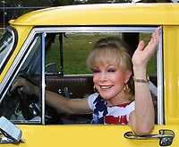 "Fort Lauderdale, FL 1-29-2002<br /> Barbara Eden (I Dream of Genie) checks <br /> out a Checker Cab at a press call <br /> at the Parker Playhouse for ""The Odd Couple"". <br /> Based on the original play, Barbara Eden <br /> plays ""Florence"" (the ""Felix"" role).<br /> Photo By Adam Scull/PHOTOlink.net"