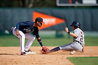 Atlanta Braves second baseman Derian Cruz (4) tags Danny Woodrow (22) sliding into second base during an Instructional League game against the Detroit Tigers on October 10, 2017 at the ESPN Wide World of Sports Complex in Orlando, Florida.  (Mike Janes/Four Seam Images)