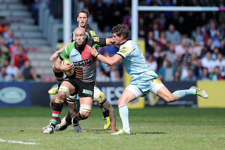 George Robson of Harlequins is tackled by Tom Wood of Northampton Saints during the Aviva Premiership match between Harlequins and Northampton Saints at the Twickenham Stoop on Saturday 4th May 2013 (Photo by Rob Munro)