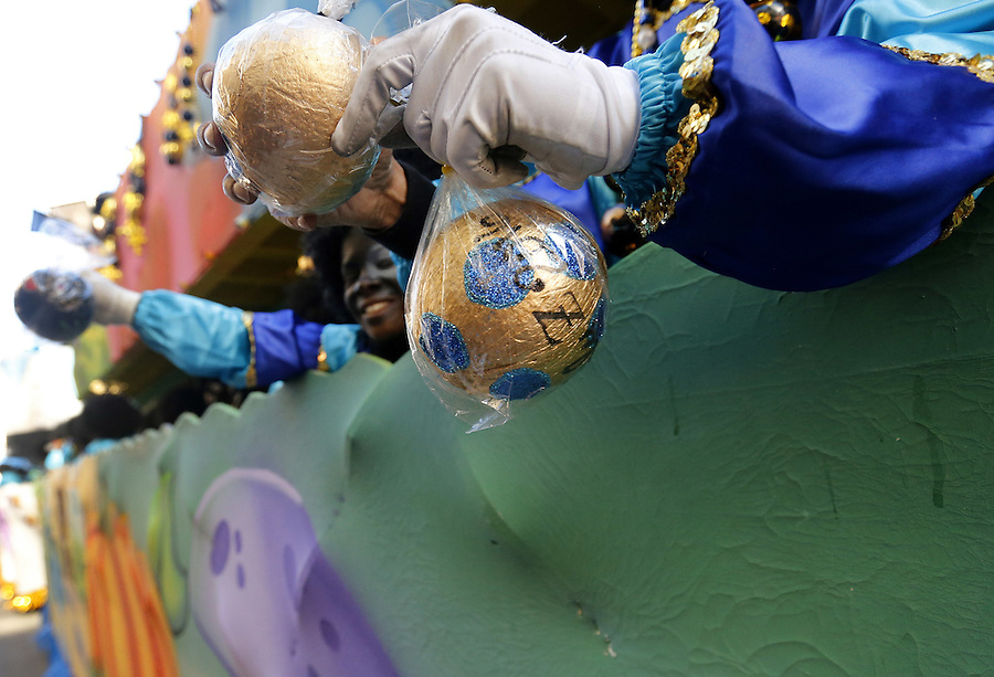 NEW ORLEANS, LOUISIANA - FEBRUARY 9, 2016:  Members of the Zulu Social Aid and Pleasure Club hand out coconuts during Mardi Gras day on February 9, 2016 in New Orleans, Louisiana. Fat Tuesday, or Mardi Gras in French, is a celebration traditionally held before the observance of Ash Wednesday and the beginning of the Christian Lenten season. (Photo by Jonathan Bachman/Getty Images)