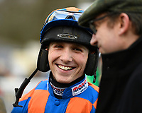Jockey Harry Cobden shares a joke with connections of Ostuni prior to The Extech Cloud-Humanising It Handicap Hurdle during Horse Racing at Plumpton Racecourse on 10th February 2020