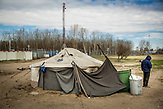Makeshift tent camp at the serbian side of the border where the conatiner camp being built in hugary.