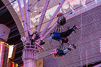 Las Vegas, Nevada.  Fremont Street.  Rescuing a Zipliner who Ran out of Momentum before Reaching the end of the Line.