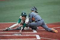 Aaron McKeithan (12) of the Charlotte 49ers collides with Tennessee Volunteers catcher Connor Pavolony (17) at Hayes Stadium on March 9, 2021 in Charlotte, North Carolina. The 49ers defeated the Volunteers 9-0. (Brian Westerholt/Four Seam Images)