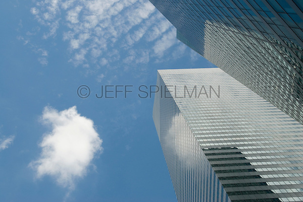 Upward View of Office Buildings and Clouds in Midtown Manhattan, New York City, New York State, USA<br /> <br /> AVAILABLE FOR LICENSING FROM GETTY IMAGES.  Please go to www.gettyimages.com and search for image # 162293654.