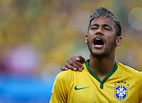 Neymar of Brazil sings his sides national anthem