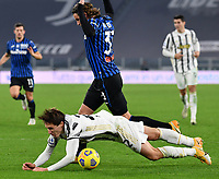 Calcio, Serie A: Juventus - Atalanta, Turin, Allianz Stadium, December 16, 2020.<br /> Juventus' Federico Chiesa (in front of) in action with Atalanta's Hans Hateboer (behind) during the Italian Serie A football match between Juventus and Atalanta at the Allianz stadium in Turin,  December 16, 2020.<br /> UPDATE IMAGES PRESS/Isabella Bonotto