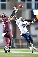 Navy cornerback Quincy Adams (5) breaks a pass intended for Texas State tight end Bradley Miller (14) during NCAA Football game, Saturday, September 13, 2014 in San Marcos, Tex. Navy leads Texas State 28-7 at the halftime.(Mo Khursheed/TFV Media via AP Images)
