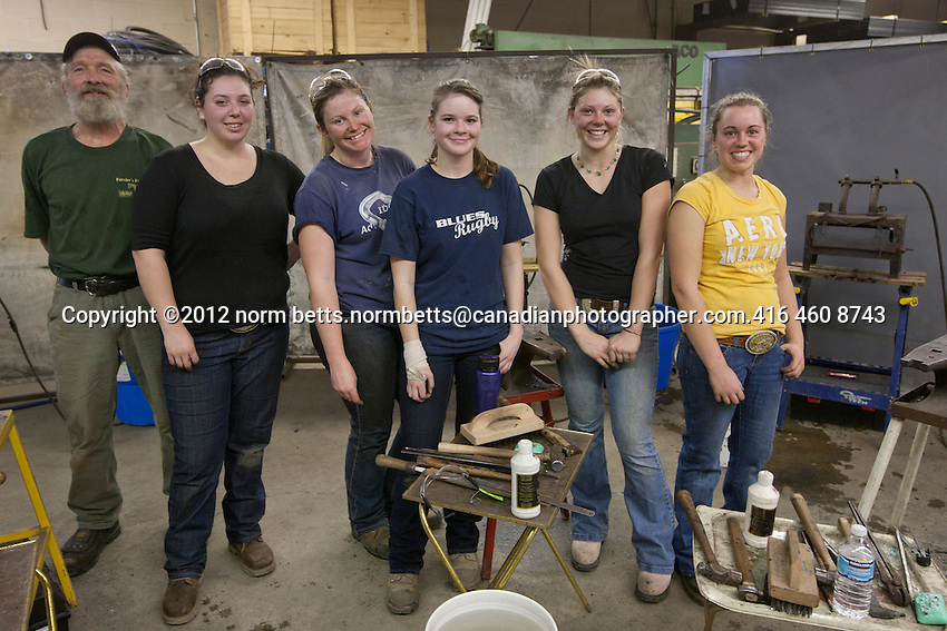 These five women in the ferrier competition are in the middle of a 15-week course at the Canadian Horseshoeing School in Embro, Ontario, Canada..left to right; Rachel Bennett, Anna Wallace, Kirstin Hurlbut, Kate Mark and Tara Cressman,  their instructor, Rienus Meyer is on the left.. at the ferrier competition at System Fencing, Rockwood, Ontario, Canada.21 January, 2012.photo by Norm Betts.416 460 8743.normbetts@canadianphotographer.com
