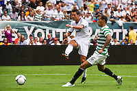 Cristiano Ronaldo (7) of Real Madrid shoots as Kelvin Wilson (6) of Celtic F. C. defends during a 2012 Herbalife World Football Challenge match at Lincoln Financial Field in Philadelphia, PA, on August 11, 2012.