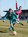Albion goalkeeper Matthew McGinley stops Arbroath's Euan Smith from getting to the ball.