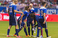 United States' midfielder Kyle Beckerman (15) is attended by the team physio after an injury during an international friendly at the Alamodome, Wednesday, April 15, 2015 in San Antonio, Tex. USA defeated Mexico 2-0. (Mo Khursheed/TFV Media via AP Images)