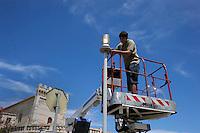 Isola di Pianosa. Pianosa Island.Elettricisti cambiano lampadine dei lampioni.Electricians change light bulbs of the lamps.