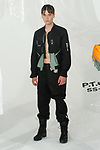 """Model poses in an outfit from the Heliot Emil Spring Summer 2018 """"P.T.C.S."""" collection by Julius Juul, for New York Mens Day at Dune Studios on July 10, 2017; duing New York Fashion Week: Mens Spring Summer 2018."""