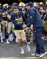 Pitt head coach Paul Chryst and senior place kicker Kevin Harper. The Pitt Panthers defeat the Rutgers Scarlet Knights 27-6 on Saturday, November 24, 2012 at Heinz Field , Pittsburgh, PA.