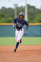 GCL Rays Abiezel Ramirez (2) rounds the bases after hitting a home run during a Gulf Coast League game against the GCL Pirates on August 7, 2019 at Charlotte Sports Park in Port Charlotte, Florida.  GCL Rays defeated the GCL Pirates 5-3 in the second game of a doubleheader.  (Mike Janes/Four Seam Images)