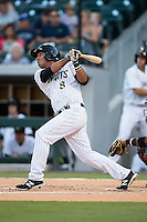 Cleuluis Rondon (8) of the Charlotte Knights follows through on his swing against the Rochester Red Wings at BB&T BallPark on August 8, 2015 in Charlotte, North Carolina.  The Red Wings defeated the Knights 3-0.  (Brian Westerholt/Four Seam Images)