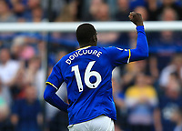 25th September 2021; Goodison Park, Liverpool, England; Premier League football, Everton versus Norwich; Abdoulaye Doucoure of Everton raises his fist to salute the Everton supporters after scoring his team's second goal after 77 minutes