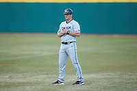 Xavier Musketeers volunteer assistant coach Ryan Sprague coaches first base during the game against the Penn State Nittany Lions at Coleman Field at the USA Baseball National Training Center on February 25, 2017 in Cary, North Carolina. The Musketeers defeated the Nittany Lions 7-5 in game two of a double header. (Brian Westerholt/Four Seam Images)