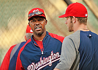 24 July 2012: Washington Nationals third base coach Bo Porter has words with outfielder Bryce Harper prior to a game against the New York Mets at Citi Field in Flushing, NY. The Nationals defeated the Mets 5-2 to take the second game of their 3-game series. Mandatory Credit: Ed Wolfstein Photo