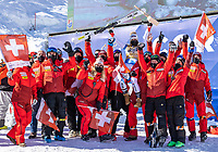 13th February 2021, Cortina, Italy; FIS World Championship Womens Downhill Skiing;   Gold medal winner and downhill world champion 2021 Corinne Suter of Switzerland with her Team during the winners ceremony