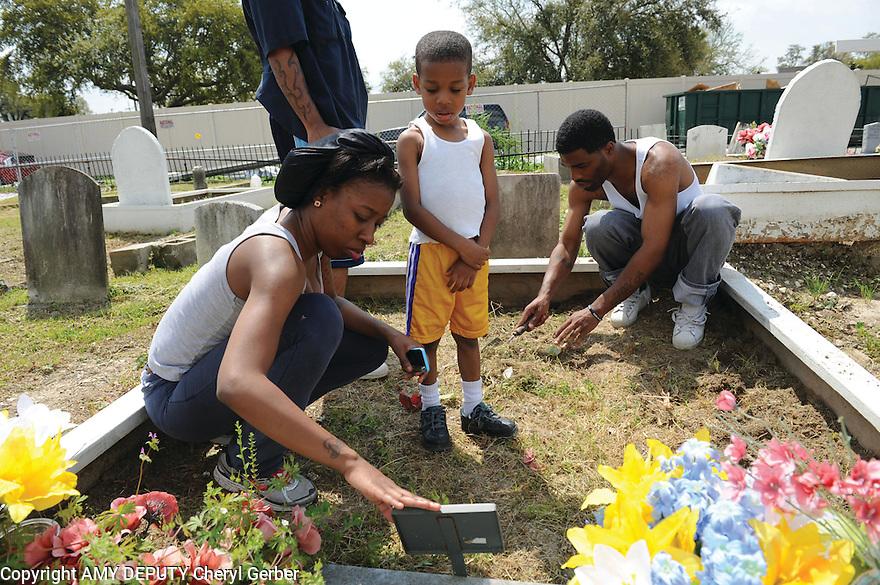 Tending the family grave in Holt Cemetery, 2014