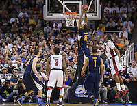 March 21st, 2013: California's Richard Solomon dunks the ball during a game against UNLV at HP Pavilion, San Jose, California. California defeated UNLV 64 - 61