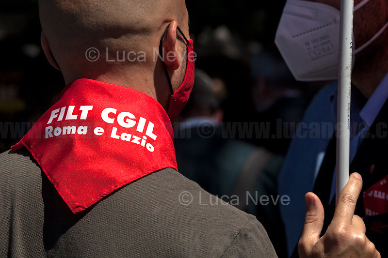 Rome, Italy. 01st June, 2021. Today, Italian local public transport workers (buses, trams and subways) of the Trade Unions Filt Cgil, Fit Cisl, Uiltrasporti, Faisa Cisal, Ugl Autoferro, Fna Autoferrotranvieri went on a 24-hour national strike to call the Government - led by Prime Minister Mario Draghi - the immediate renewal of the National Collective Contract which had expired more than three years ago. The photos in this story were taken outside the Ministry of Transport in Rome's near Porta Pia were a rally was held with the partecipation, amongts others, of the Cgil General Secretary, Maurizio Landini.   <br /> <br /> Footnotes & Links:<br /> CGIL: http://cgil.it/ & https://bit.ly/2E1Al5a (Wikipedia)<br /> CISL: https://www.cisl.it /& https://bit.ly/2tj5Txa (Wikipedia)<br /> UIL: http://www.uil.it/ & https://bit.ly/2Glf88D (Wikipedia)