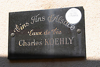 carved stone sign dom c koehly rodern alsace france