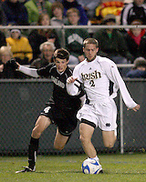 Ryan Miller #2 of Notre Dame holds off a challenge by Sebastian Harris #4 of Oakland. The University of Notre Dame defeated Oakland University 2-1 in the second round of the NCAA championship at Alumni Field at the University of Notre Dame in South Bend, Indiana on November 28, 2007.