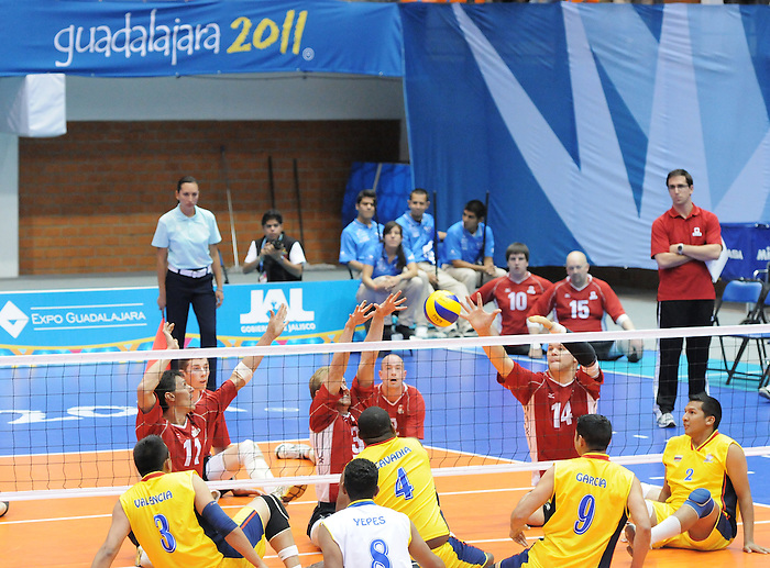 Jose Rebelo, Austin Hinchey and Greg Stewart, Guadalajara 2011 - Sitting Volleyball // Volleyball Assis.<br /> Team Canada takes on Columbia in the Bronze Medal Game // Équipe Canada affronte Columbia dans le match pour la médaille de bronze. 11/18/2011.