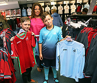 Pictured L-R: Jack Lewis, 9, Maria Thomas and Bailey Dyer, 10. Saturday 01 July 2017<br /> Re: The new 2017-2018 season, Swansea City FC kit has officially gone on sale at the club's Liberty Stadium shop, Wales, UK