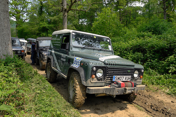 Land Rover Defender 90 TD4 waiting to compete in the ALRC National 2008 RTV Trial. The Association of Land Rover Clubs (ALRC) National Rallye is the biggest annual motor sport oriented Land Rover event and was hosted 2008 by the Midland Rover Owners Club at Eastnor Castle in Herefordshire, UK, 22 - 27 May 2008. --- No releases available. Automotive trademarks are the property of the trademark holder, authorization may be needed for some uses.