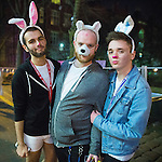 © Joel Goodman - 07973 332324 . Manchester , UK . 05/04/2015 . Three men wearing seasonal rabbit ears , on Canal Street , in Manchester's Gay Village . Revellers on a Saturday night out during the Easter Bank Holiday weekend . Photo credit : Joel Goodman