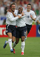 English midfielder (7) David Beckham celebrates his goal with teammate (3) Ashley Cole.  England defeated Ecuador, 1-0, in their FIFA World Cup round of 16 match at Gottlieb-Daimler-Stadion in Stuttgart, Germany, June 25, 2006.