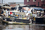 Boats are a daily means of transportation all along the coast of Benin.  Here in Cotonou, residents arrive and depart from Dantokpa Market by boat.