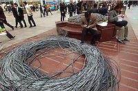 Internet cable is laid Nanjing Lu, Shanghai, China. As of December 2004 China had 43 million broadband subscribers and that figure will quadruple in the next two years as cable is laid. .14-APR-05