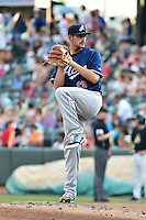 Reno Aces starting pitcher Mark Serrano (13) delivers a pitch to the plate against the Salt Lake Bees in Pacific Coast League action at Smith's Ballpark on July 24, 2014 in Salt Lake City, Utah.  (Stephen Smith/Four Seam Images)